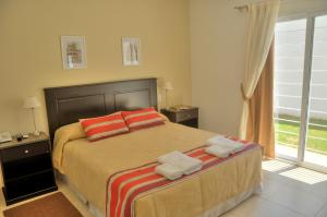 A bed or beds in a room at Laplace Hotel