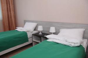 Кровать или кровати в номере Victory Hotel