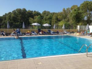 The swimming pool at or near Complesso L'Oasi