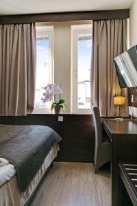 Letto o letti in una camera di Brunnby Hotel