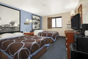 A television and/or entertainment centre at Super 8 by Wyndham Massena NY
