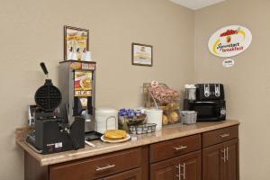 A kitchen or kitchenette at Super 8 by Wyndham Massena NY