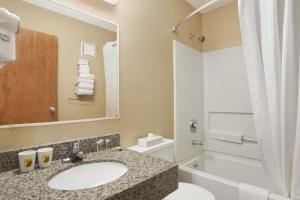 A bathroom at Super 8 by Wyndham Massena NY