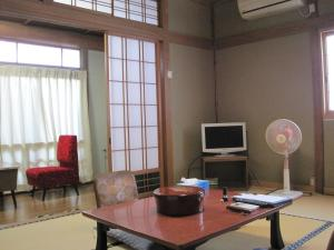 A seating area at Suminoe Ryokan