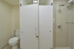 A bathroom at Whiz Hotel Malioboro Yogyakarta