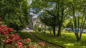 A garden outside Pinehurst Lodge Hotel - Aberdeen