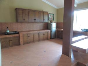 A kitchen or kitchenette at Villa Tjokro
