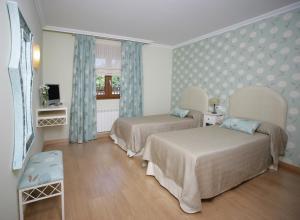 Cama o camas de una habitación en Posada El Corcal de Liébana