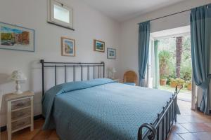 A bed or beds in a room at Agriturismo Villa Caterina