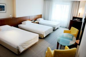 A bed or beds in a room at Hotel Molino Shin Yuri