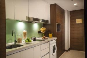 A kitchen or kitchenette at Ascott Raffles City Chengdu
