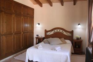 A bed or beds in a room at Villa Ana