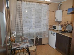 Кухня или мини-кухня в Апартаменты на Ул. Черняховского 18