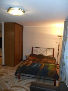 Кровать или кровати в номере Апартаменты на Ул. Черняховского 18