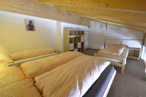 A bed or beds in a room at Appartmenthaus Bergfreund