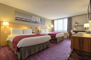 A bed or beds in a room at Mercure Paris Velizy