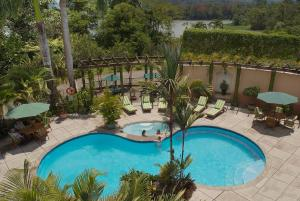 A view of the pool at Hotel Casa Turire or nearby