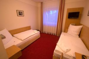 Ein Bett oder Betten in einem Zimmer der Unterkunft Hotel Jacobsberg