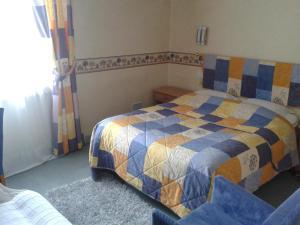 Un ou plusieurs lits dans un hébergement de l'établissement Hotel Restaurant Robichon