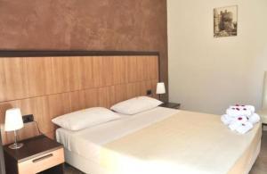 A bed or beds in a room at B&B La Zudrea