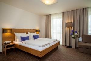Ein Bett oder Betten in einem Zimmer der Unterkunft Rumer Hof