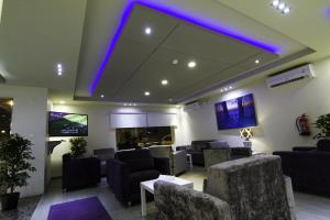O lounge ou bar de Rofan Hotel Suites