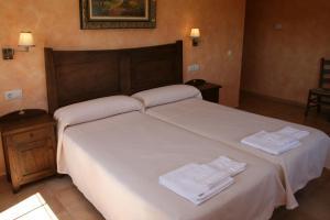 Кровать или кровати в номере Casa Rural Las Canteras