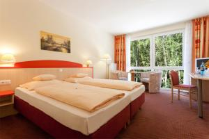A bed or beds in a room at Morada Hotel Isetal