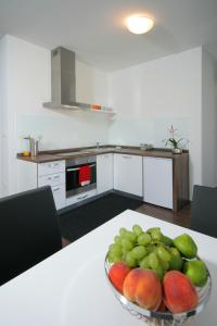 A kitchen or kitchenette at Charm Apartments And Rooms