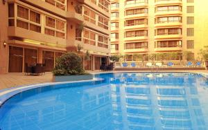 The swimming pool at or near Pyramisa Suites Hotel Cairo