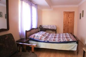 Łóżko lub łóżka w pokoju w obiekcie Dodo Japaridze Guesthouse