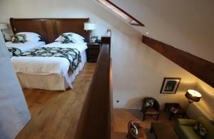 A bed or beds in a room at Bushmills Inn Hotel & Restaurant