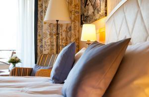 Кровать или кровати в номере Boutique-Hotel Remorino