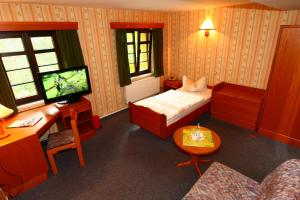 Ein Bett oder Betten in einem Zimmer der Unterkunft Hotel Wenzels Hof