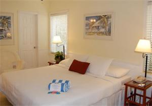 A bed or beds in a room at Worthington All Male Guesthouse