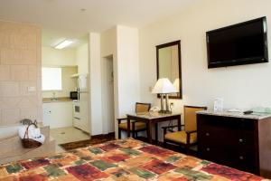 A television and/or entertainment center at Sands Inn & Suites