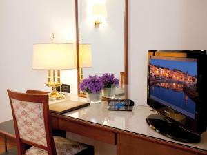 A television and/or entertainment center at Hotel Marconi
