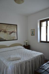 A bed or beds in a room at B&B A Casa Dell'Iside