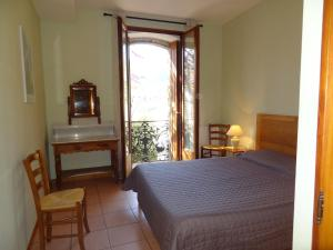 A bed or beds in a room at Les Santolines