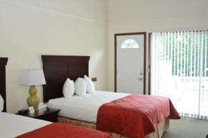 A bed or beds in a room at Tea Island Resort