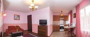Телевизор и/или развлекательный центр в Квартира на Октябрьской