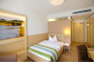 Ein Bett oder Betten in einem Zimmer der Unterkunft Hotel Wende