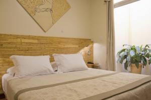 Кровать или кровати в номере Villa do Poeta