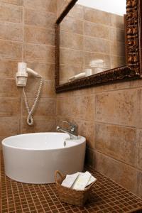 Ein Badezimmer in der Unterkunft Hotel 2D Resort and Spa
