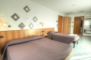 Postel nebo postele na pokoji v ubytování Hotel Alisei