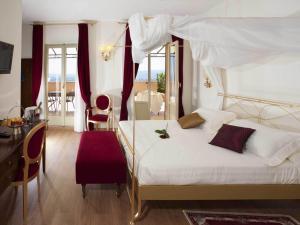 ジオット ホテル & スパにあるベッド