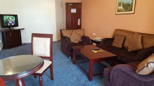 A seating area at Al Bustan Tower Hotel Suites