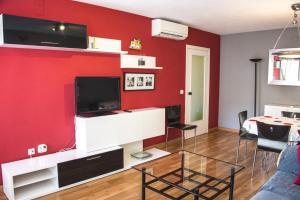 Una televisión o centro de entretenimiento en Apartamento Valencia Center II