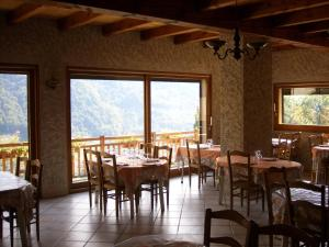 A restaurant or other place to eat at Ferme Auberge du Bessard