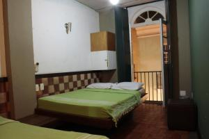 A bed or beds in a room at Laranjeiras Hostel